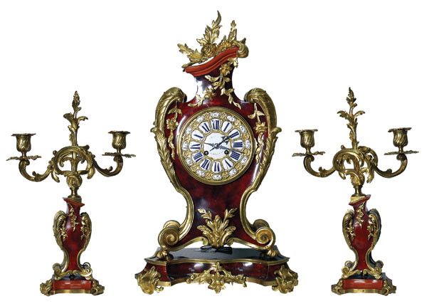 Fireplace set: clock and pair of candelabrum.