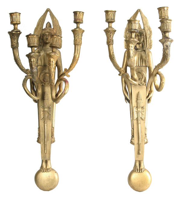 Paired wall candlesticks.